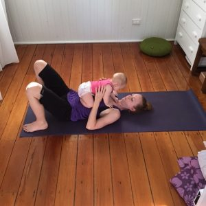 Allison and Elsie practice yoga together